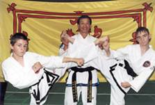 Grand Master Park Jung Tae with Intrepid Junior Black Belts